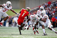 A slew of Buckeyes tackle Maryland Terrapins wide receiver Stefon Diggs (1) during the first quarter of the NCAA football game at Byrd Stadium in College Park, Maryland on Oct. 4, 2014. (Adam Cairns / The Columbus Dispatch)