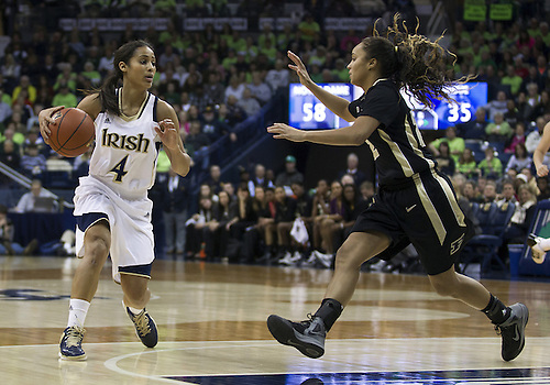 December 29, 2012:  Notre Dame guard Skylar Diggins (4) dribbles the ball as Purdue guard KK Houser (22) defends during NCAA Women's Basketball game action between the Notre Dame Fighting Irish and the Purdue Boilermakers at Purcell Pavilion at the Joyce Center in South Bend, Indiana.  Notre Dame defeated Purdue 74-47.