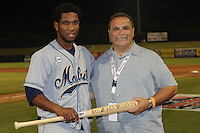 Mississippi Braves general manager Steve Desalvo presents the Top Star Award to Mobile Bay Bears right fielder Alfredo Marte #21 after the Southern League All-Star Game  at Smokies Park on June 19, 2012 in Kodak, Tennessee.  The South Division defeated the North Division 6-2. (Tony Farlow/Four Seam Images).