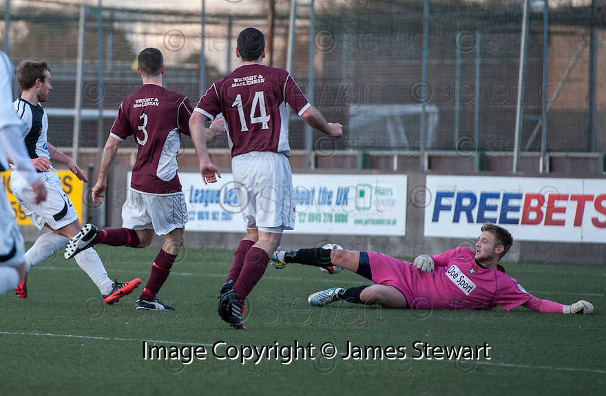 Stenny's Eddie Malone (3) scores the late equaliser. <br /> <br /> <br /> 15/02/2014   jspa011_smuir_v_efife     <br /> Copyright  Pic : James Stewart   <br /> <br /> James Stewart Photography 19 Carronlea Drive, Falkirk. FK2 8DN      Vat Reg No. 607 6932 25   Tel:  +44 (0)7721 416997<br /> E-mail  :  jim@jspa.co.uk   If you require further information then contact Jim Stewart on any of the numbers above........