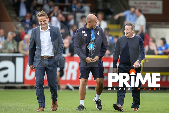 Chesterfield Manager Danny Wilson (right) chats to Wimbledon Assistant Coach Neil Cox (centre) as AFC Wimbledon Manager Neal Ardley looks on during the Sky Bet League 1 match between AFC Wimbledon and Chesterfield at the Cherry Red Records Stadium, Kingston, England on 3 September 2016. Photo by Andy Rowland / PRiME Media Images.