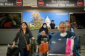 Passengers arrive from Dubai after a 14-hour flight on Emirates flight 231, at the international terminal at Dulles International Airport in Dulles, Va., Monday, March16, 2020. Some people are taking the precaution of wearing face masks as they arrive to be greeted by family and or friends. Credit: Rod Lamkey / CNP