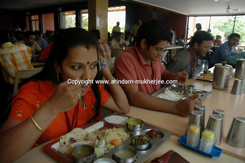 Pooja having lunch at the canteen of Wipro technologies in Bangalore. She is a project manager at Wipro softwares in Bangalore. Wipro is the second largest software company in the country and the head office is in Bangalore, Karnataka, India. Arindam Mukherjee