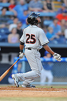 Delmarva Shorebirds left fielder Gregory Lorenzo #25 swings at a pitch during opening night game against the Asheville Tourists at McCormick Field on April 3, 2014 in Asheville, North Carolina. The Tourists defeated the Shorebirds 8-3. (Tony Farlow/Four Seam Images)