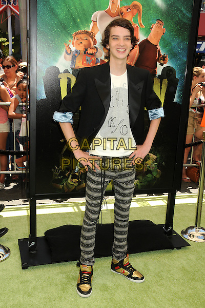 "Kodi Smit-McPhee.""ParaNorman"" Los Angeles Premiere held at AMC CityWalk Stadium 19 Theatre, Universal City, California, USA..August 5th, 2012.full length black suit jacket top white top grey gray striped stripes trousers hands on hips .CAP/ADM/BP.©Byron Purvis/AdMedia/Capital Pictures."