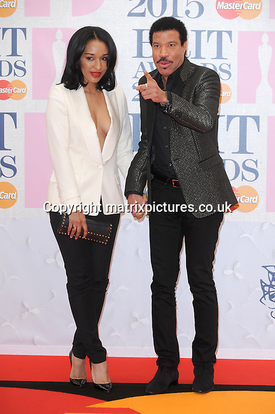 NON EXCLUSIVE PICTURE: PAUL TREADWAY / MATRIXPICTURES.CO.UK<br /> PLEASE CREDIT ALL USES<br /> <br /> WORLD RIGHTS<br /> <br /> American singer-songwriter Lionel Richie attending the BRIT Awards 2015 at the O2 Arena, in London.<br /> <br /> FEBRUARY 25th 2015<br /> <br /> REF: PTY 15627