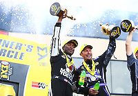 Jul 10, 2016; Joliet, IL, USA; NHRA top fuel driver Antron Brown (left) and funny car driver Jack Beckman celebrate after winning the Route 66 Nationals at Route 66 Raceway. Mandatory Credit: Mark J. Rebilas-USA TODAY Sports