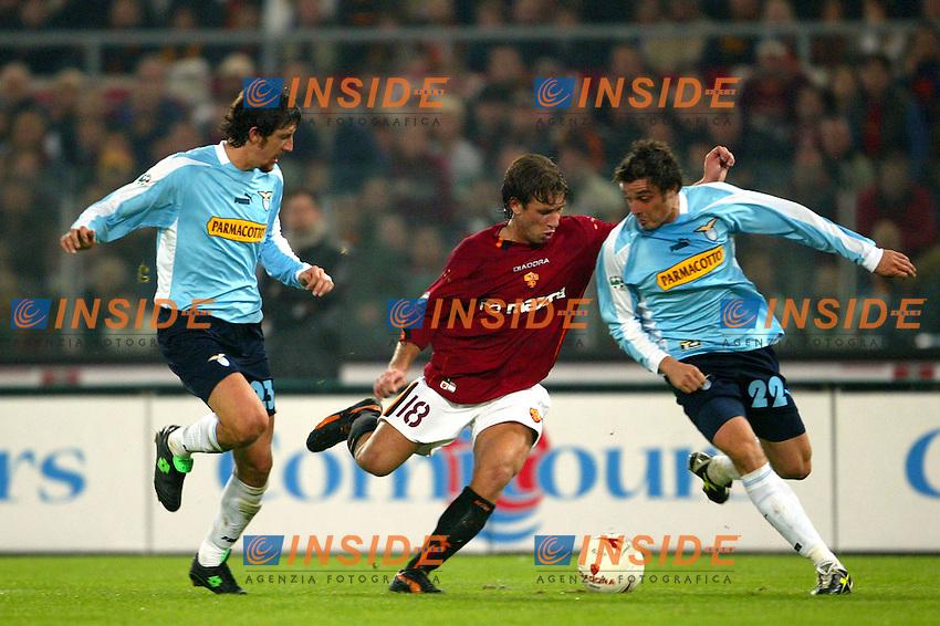 Roma 9/11/2003 <br /> Roma Lazio 2-0 <br /> Antonio Cassano (Roma) between Paolo Negro (left) and Massimo Oddo (right) Lazio<br /> Foto Andrea Staccioli Insidefoto