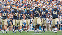 the Pitt defense takes the field. Pictured are Anthony Gonzalez (28),  Reggie Mitchell (15), Matt Galambos (47), Luke Maclean (55), Shakir Soto (52), Justin Moody (56) and Tyrique Jarrett (54). Iowa Hawkeyes defeated the Pitt Panthers 24-20 at Heinz Field, Pittsburgh Pennsylvania on September 20, 2014.