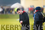 Piarsaigh na Dromoda's manager Declan O'Sullivan checks his watch to see what's remaining.