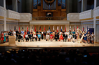 Contestants, special guests and jury members are pictured on stage during the opening ceremony of the 11th USA International Harp Competition at Indiana University in Bloomington, Indiana on Wednesday, July 3, 2019. (Photo by James Brosher)