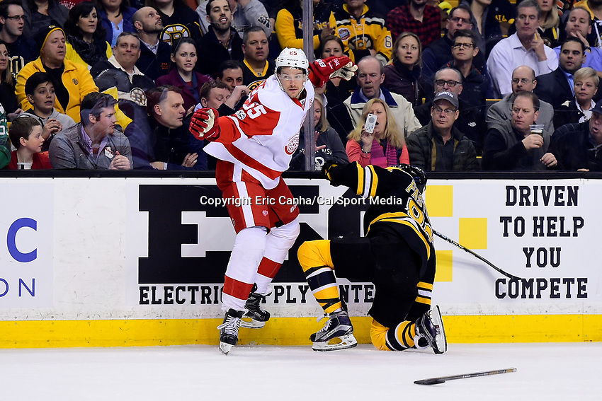 Wednesday, March 8, 2017: Detroit Red Wings defenseman Danny DeKeyser (65) loses his stick on a check with Boston Bruins right wing David Pastrnak (88) during the National Hockey League game between the Detroit Red Wings and the Boston Bruins held at TD Garden, in Boston, Mass.  Boston defeats Detroit 6-1 in regulation time. Eric Canha/CSM