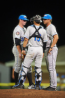 Hudson Valley Renegades pitching coach Brian Reith (46) talks with relief pitcher Garrett Fulenchek (37) and catcher Daniel De La Calle (13) during a game against the Batavia Muckdogs on August 1, 2016 at Dwyer Stadium in Batavia, New York.  Hudson Valley defeated Batavia 5-1.  (Mike Janes/Four Seam Images)