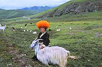 Tibetm Kham. Nomad boy keeping warm in his fur hat.