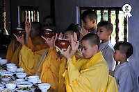 Monks in temple praying before lunch (Licence this image exclusively with Getty: http://www.gettyimages.com/detail/83154212 )