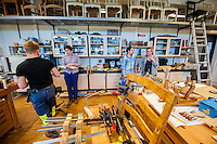 Cabinetmaking and furniture conservation students receiving instruction from professor Charlotta Ekholm (far right) and collaborating with each other.