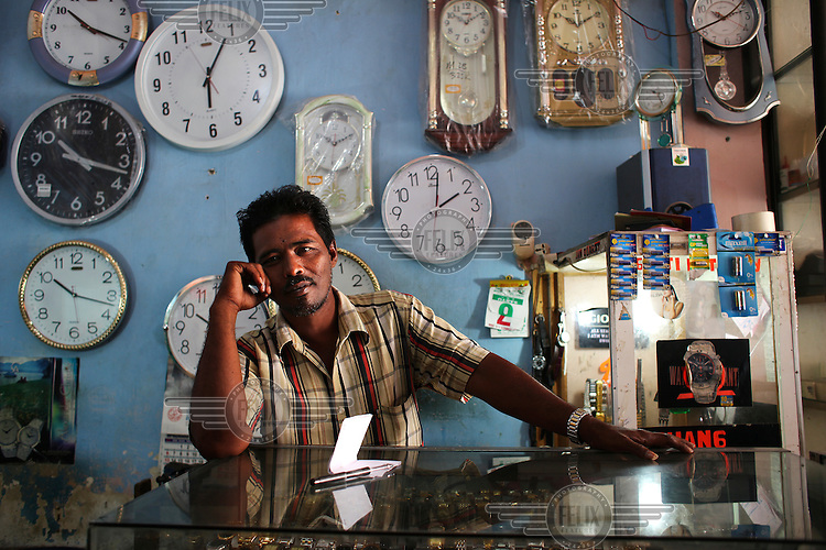 A man works at Reza'a Clock shop, a new business which has opened up in Banda Aceh.