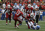Gene McCaskill takes a tackle during the game against the University of Louisville Cardinals on Sunday, Sept. 2, 2012 in Papa John's Stadium in Louisville, Ky. Louisville won 32-14. Photo by Latara Appleby | Staff