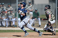 Upper Iowa University Peacocks outfielder Eric Cottrell (10) at bat in front of catcher Alex Bell during a game against Slippery Rock University at Frank Tack Field on March 14, 2014 in Clearwater, Florida.  Slippery Rock defeated Upper Iowa 14-9.  (Mike Janes/Four Seam Images)
