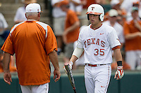 Texas Longhorns designated hitter Madison Carter (35) talks with head coach Augie Garrido during the NCAA Super Regional baseball game against the Houston Cougars on June 7, 2014 at UFCU Disch–Falk Field in Austin, Texas. The Longhorns are headed to the College World Series after they defeated the Cougars 4-0 in Game 2 of the NCAA Super Regional. (Andrew Woolley/Four Seam Images)