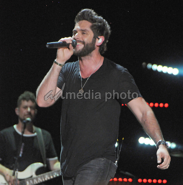 12 June 2016 - Nashville, Tennessee - Thomas Rhett. 2016 CMA Music Festival Nightly Concert held at Nissan Stadium. Photo Credit: Dara-Michelle Farr/AdMedia