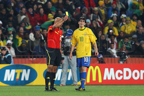 JUNE 28, 2010 - Football : 2010 FIFA World Cup South Africa Round of 16 between Brazil 3-0 Chile at Ellis Park Stadium, Johannesburg, South Africa. Kaka (BRA)  gets a yellow card from referee Howard Webb, .