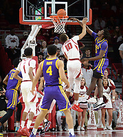 NWA Democrat-Gazette/ANDY SHUPE<br /> Arkansas forward Daniel Gafford (10) is dunked on by LSU forward Naz Reid (right) Friday, Jan. 11, 2019, during the first half of play in Bud Walton Arena in Fayetteville. Visit nwadg.com/photos to see more photographs from the game.