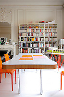 The dining area is dominated by a bookshelf by Shiro Kuramata and a table by Pucci de Rossi