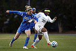 30 November 2013: North Carolina's Meg Morris (32) and UCLA's Jenna Richmond (left). The University of North Carolina Tar Heels played the University of California Los Angeles Bruins at Fetzer Field in Chapel Hill, North Carolina in a 2013 NCAA Division I Women's Soccer Tournament Quarterfinal match. UCLA won the game 1-0 in two overtimes.