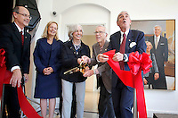 NWA Democrat-Gazette/DAVID GOTTSCHALK  Don Bobbitt (from left), president of the University of Arkansas System, Ronda Mains, chair of the music department, Joyce and Jim Faulkner and Dan Ferritor, interim chancellor, participate in a ribbon cutting ceremony Friday, September 18, 2015 in the lobby of the new Jim and Joyce Faulkner Performing Arts Center on the campus in Fayetteville. Jim and Joyce Faulkner made a $6 million donation to the university in 2012 specifically toward renovating and remodeling the Field House into a performing arts center.