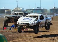 Apr 16, 2011; Surprise, AZ USA; LOORRS driver Jesse Johnson (15) and C.J. Greaves (33) during round 3 at Speedworld Off Road Park. Mandatory Credit: Mark J. Rebilas-.