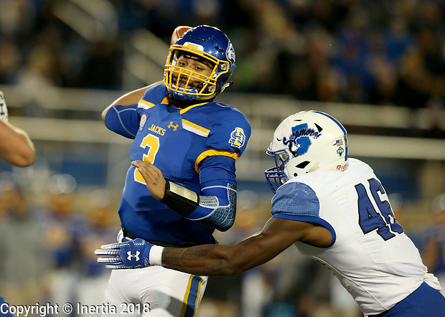 BROOKINGS, SD, OCTOBER 6: Taryn Christion #3 from South Dakota State University passes the ball while being pressured by Jonas Griffith #46 from Indiana State during their game Saturday night at Dana J. Dykhouse Stadium in Brookings. (Dave Eggen/Inertia)