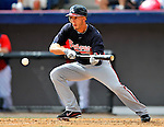 4 March 2011: Atlanta Braves outfielder Jordan Schafer lays down a bunt during a Spring Training game against the Washington Nationals at Space Coast Stadium in Viera, Florida. The Braves defeated the Nationals 6-4 in Grapefruit League action. Mandatory Credit: Ed Wolfstein Photo