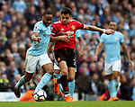 Raheem Sterling of Manchester City tackled by Alexis Sanchez of Manchester United during the premier league match at the Etihad Stadium, Manchester. Picture date 7th April 2018. Picture credit should read: Simon Bellis/Sportimage