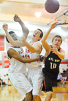 Lareco Robinson, Colin Diehl, and Tyler Williams all lunge for a loose ball after colliding with each other in the air during Fauquier's 60-53 win over Kettle Run at Fauquier H.S..