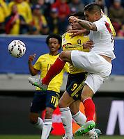 TEMUCO - CHILE – 21-04-2015: Radamel Falcao Garcia (Izq.) jugador de Colombia, disputa el balón con Juan Vargas (Der.) jugador de Peru, durante partido Colombia y Peru, por la fase de grupos, Grupo C, de la Copa America Chile 2015, en el estadio German Becker en la Ciudad de Temuco  / Radamel Falcao Garcia (L) player of Colombia, vies for the ball with Juan Vargas (R) player of Peru, during a match between Colombia and Peru, for the group phase, Group C, of the Copa America Chile 2015, in the German Becker stadium in Temuco city. Photos: VizzorImage /  Photosport / Dragomir Yankovic    / Cont.
