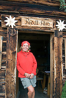 Bad Hofgastein, Salzburgerland, Austria, September 2009. Jillian joins the farm and rounds up cows, milks the and makes cheese. Sepp Duernberger of the Riedlalm in Bad Gastein keeps lama's for hiking with tourists, at his mountain pasture farm house. Photo by Frits Meyst