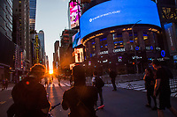 NEW YORK, NEW YORK - JUNE 1: Protesters stand on the street as they watch the phenomenon known as Manhattanhenge in Times Square on June 1, 2020 in New York. The protests spread across the country in at least 30 cities across the United States, over the death of unarmed black man George Floyd at the hands of a police officer, this is the latest death in a series of police deaths of black Americans. Today is the first night of a curfew in New York City (Photo by Pablo Monsalve / VIEWpress via Getty Images)