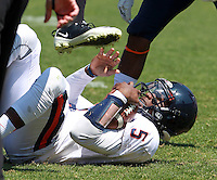 Virginia quarterback David Watford (5) is taken down during the annual Virginia football Orange-Blue Spring Game Saturday at Scott Stadium in Charlottesville, VA. Photo/The Daily Progress/Andrew Shurtleff