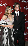 PALM SPRINGS, CA. - January 06: Actress Mira Sorvino and husband Christopher Backus arrive at The 20th Anniversary of the Palm Springs International Film Festival Awards Gala at the Palm Springs Convention Center in on December 6, 2009 in Palm Springs, California.