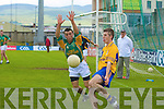 Edward O'Sullivan, Beaufort tries to block the ball from Gavin O'Connor, Castlegregory in their Junior Club Championship final in Austin Stack Park on Sunday.