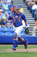 New York Mets catcher Travis d'Arnaud (15) during a spring training game against the Washington Nationals on March 27, 2014 at Tradition Field in St. Lucie, Florida.  Washington defeated New York 4-0.  (Mike Janes/Four Seam Images)