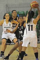 Action from the 2013 FIBA Oceania Pacific Championship women's 5th place playoff match between Fiji (black) and Samoa (white) at Te Rauparaha Arena, Porirua, Wellington, New Zealand on Wednesday, 4 December 2013. Photo: Dave Lintott / lintottphoto.co.nz