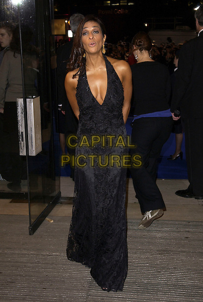 SHOBNA GULATI.National Television Awards 2005 at the Royal Albert Hall, SW7, London, UK..October 25th, 2005.Ref: FIN.full length black dress plunging neckline cleavage funny face.www.capitalpictures.com.sales@capitalpictures.com.© Capital Pictures.