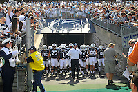 07 September 2013:  Penn State coach Bill O'Brien leads the team out the tunnel onto the field. The Penn State Nittany Lions defeated the Eastern Michigan Eagles at Beaver Stadium in State College, PA.