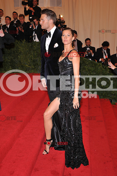 Tom Brady and Gisele Bundchen at the 'Schiaparelli And Prada: Impossible Conversations' Costume Institute Gala at the Metropolitan Museum of Art on May 7, 2012 in New York City. © mpi03/MediaPunch Inc.