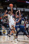 Ariel Stephenson (25) of the Wake Forest Demon Deacons drives to the basket past Zaire O'Neil (21) and Chanin Scott (24) of the Georgia Tech Yellow Jackets during first half action at the LJVM Coliseum on January 22, 2017 in Winston-Salem, North Carolina.  The Demon Deacons defeated the Yellow Jackets 70-65 in overtime.  (Brian Westerholt/Sports On Film)