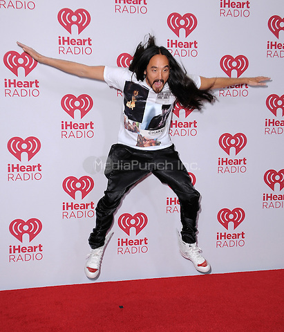 LAS VEGAS, NV - SEPTEMBER 19:  Steve Aoki with at the 2014 iHeartRadio Music Festival at the MGM Grand Garden Arena on September 19, 2014 in Las Vegas, Nevada. PGSK/MediaPunch