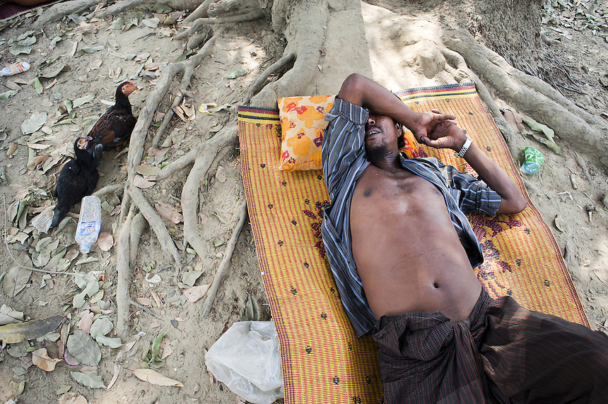 A Muslim man rests in Kyawe Pone Lay in Oakkan Township. The village was attacked by a mob, some of which they knew by name, in the early evening on April 30. Following the incident, 100 of the 500 residents have fled to Yangon.