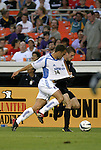 15 May 2004: Joshua Gros (rear) tugs on Jack Jewsbury's (14) jersey while trying to get past him in the first half. DC United defeated the Kansas City Wizards 1-0 at RFK Stadium in Washington, DC during a regular season Major League Soccer game..